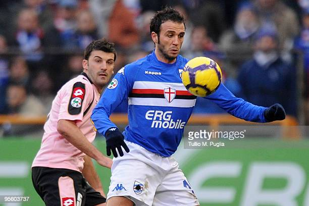Giampaolo Pazzini of Sampdoria and Cesare Bovo of Palermo compete for the ball during the Serie A match between UC Sampdoria and US Citta di Palermo...
