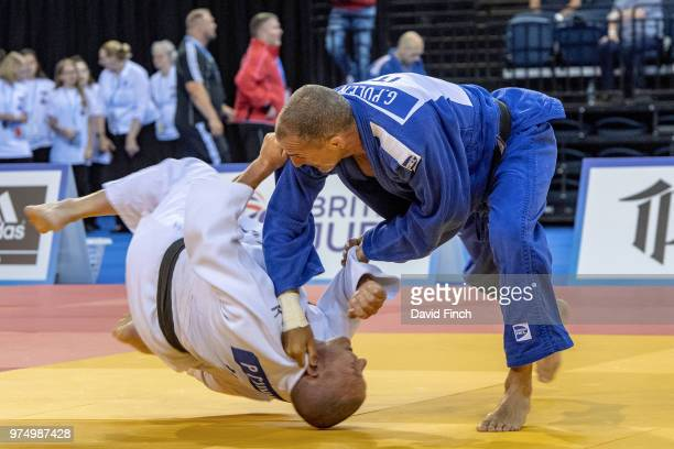 Giampaolo Polenta of Italy flips Paul Cummins of Ireland on to his back for an ippon to win their M5 u81kg opening contest as he progressed to...