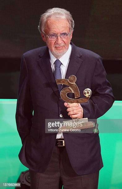Giampaolo Pozzo poses with the AIC Award during the Gran Gala del calcio Aic 2011 awards ceremony at Teatro dal Verme on January 23, 2012 in Milan,...