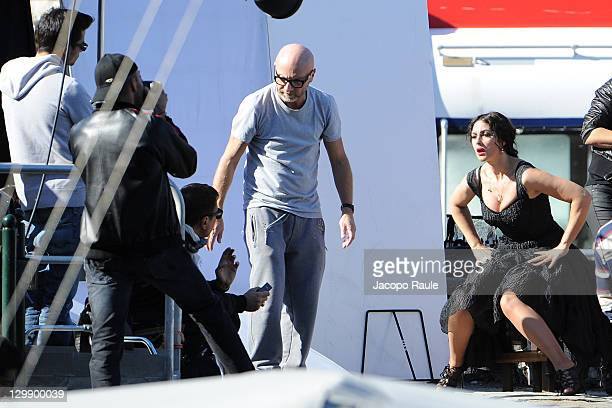 Giampaolo Sgura Stefano Gabbana Domenico Dolce and Monica Bellucci sighting on the set of a Dolce Gabbana commercial on October 21 2011 in Portofino...
