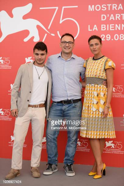 Giampiero De Concilio Ciro D'Emilio and Anna Foglietta attend Un Giorno All'Improvviso photocall during the 75th Venice Film Festival at Sala Casino...