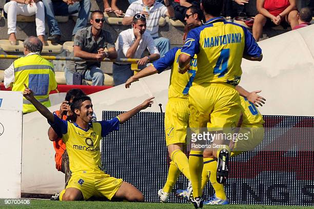 Giampiero Pinzi of Chievo Verona AC celebrates with teamates after scoring the first goal during the match between Bologna FC and Chievo Verona AC at...