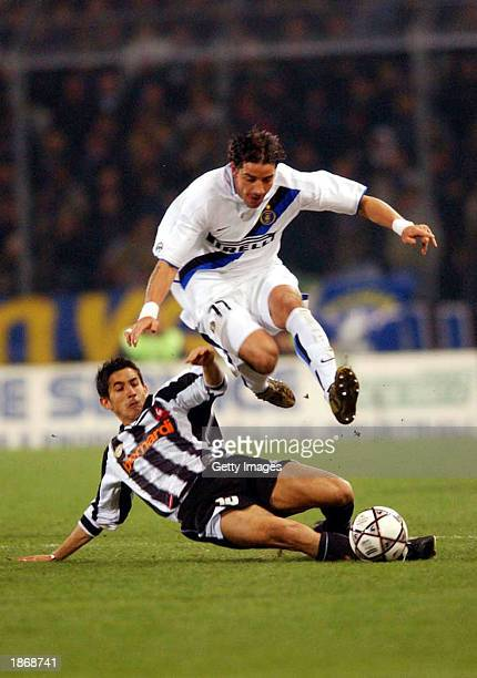 Giampiero Pinzi of Udinese and Francesco Coco of Inter Milan in action during the Serie A match between Udinese and Inter Milan played at the Friuli...