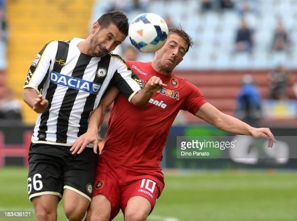 Giampiero Pinzi of Udinese competes with Agim Ibraimi of Cagliari during the Serie A match between Udinese Calcio and Cagliari Calcio at Stadio...