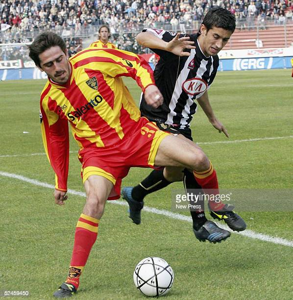 Giampiero Pinzi of Udinese is blocked by Alex Pinardi of Lecce during the Serie A match between Udinese and Lecce on March 20 2005 in Udine Italy