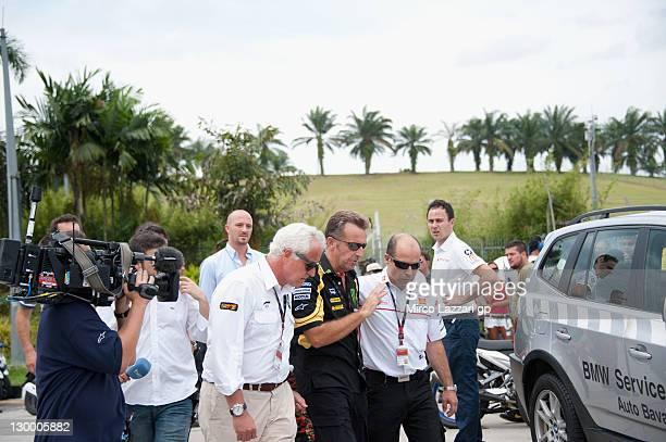 Giampiero Sacchi Herve Poncharal and Fausto Gresini of San Carlo Honda Gresini speak at a medical facility after the MotoGP of Malaysia was stopped...