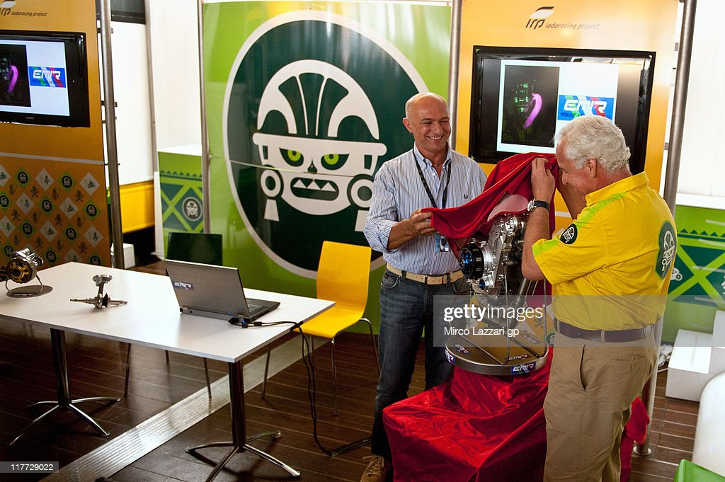Giampiero Sacchi (R) of Italy presents Emir GP 3, the new engine of Ioda Racing and Robby Moto Engineering for the new category Moto3 (season 2012) during the MotoGp of Italy at Mugello Circuit on June 30, 2011 in Scarperia near Florence, Italy.