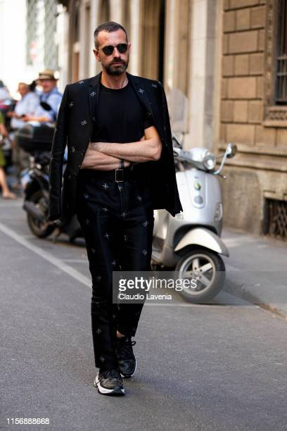 Giampietro Baudo wearing a black Fendi printed suit black tshirt and black sneakers is seen outside Giorgio Armani show during the Milan Men's...