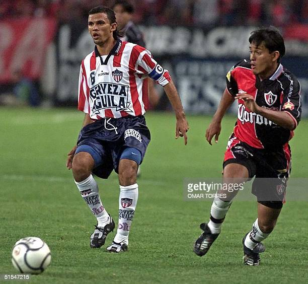 Gian Carlos Torres of the Junior of Barranquilla and Diego Cocca of Atlas of Mexico looks for the ball in a game 03 May 2000 AFP PHOTO/Omar TORRES
