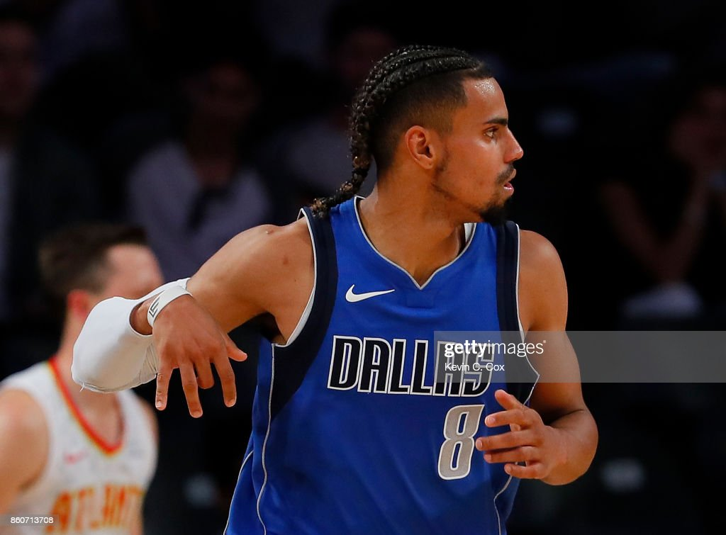 Gian Clavell #8 of the Dallas Mavericks reacts after hitting a three-point basket against the Atlanta Hawks at McCamish Pavilion on October 12, 2017 in Atlanta, Georgia.