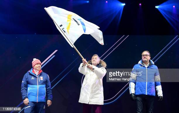 Gian Franco Kasper, president of FIS, waves the FIS flag during the opening ceremony for the FIS Nordic World Ski Championships on February 20, 2019...