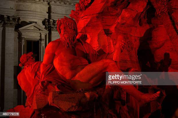 Gian Lorenzo Bernini's Fountain of the Four Rivers is lit in red for the traditional Christmas decorations in Rome's Piazza Navona on December 22...