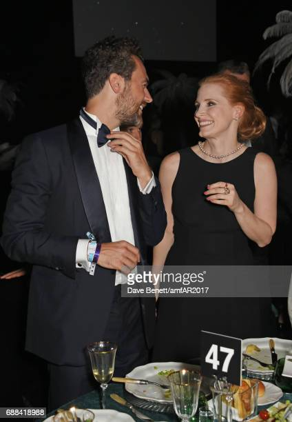 Gian Luca Passi de Preposulo and Jessica Chastain attend the amfAR Gala Cannes 2017 at Hotel du CapEdenRoc on May 25 2017 in Cap d'Antibes France