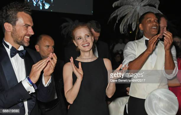 Gian Luca Passi de Preposulo Jessica Chastain and Will Smith attend the amfAR Gala Cannes 2017 at Hotel du CapEdenRoc on May 25 2017 in Cap d'Antibes...