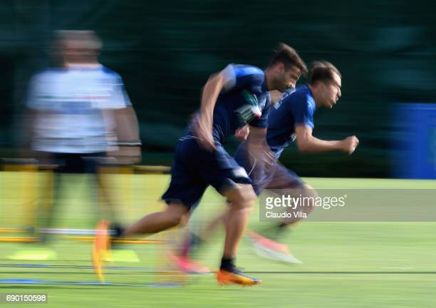 Gian Marco Ferrari and Federico Chiesa of Italy in action during the training session at Coverciano at Coverciano on May 30 2017 in Florence Italy
