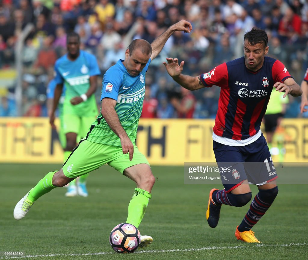 Gian Marco Ferrari (R) of Crotone competes for the ball with Rodrigo Palacio of Inter during the Serie A match between FC Crotone and FC Internazionale at Stadio Comunale Ezio Scida on April 9, 2017 in Crotone, Italy.