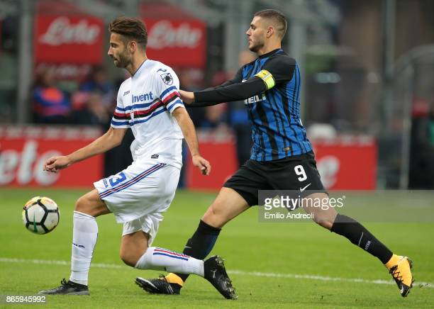 Gian Marco Ferrari of UC Sampdoria competes for the ball with Mauro Emanuel Icardi of FC Internazionale Milano during the Serie A match between FC...