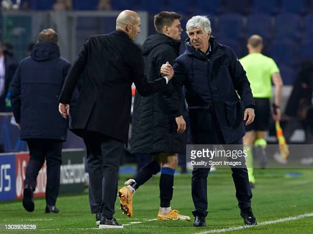 Gian Piero Gasperini, Manager of Atalanta BC shakes hands with Zinedine Zidane, Manager of Real Madrid after the UEFA Champions League Round of 16...