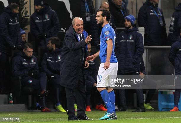 Gian Piero Ventura coach of Italy speaks with Marco Parolo of Italy during the FIFA 2018 World Cup Qualifier PlayOff Second Leg between Italy and...