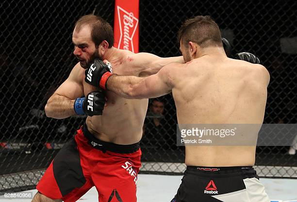 Gian Villante and Saparbek Safarov of Russia trade punches in their light heavyweight bout during the UFC Fight Night event at the Times Union Center...