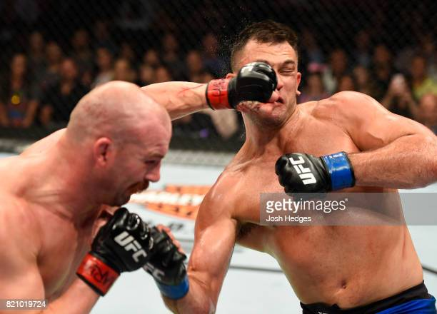 Gian Villante exchanges punches with Patrick Cummins in their light heavyweight bout during the UFC Fight Night event inside the Nassau Veterans...