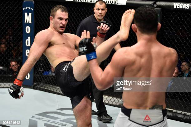 Gian Villante kicks Francimar Barroso of Brazil in their light heavyweight bout during the UFC 220 event at TD Garden on January 20 2018 in Boston...