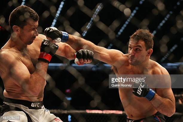 Gian Villante of the United States punches Anthony Perosh of Australia in their light heavyweight bout during the UFC 193 event at Etihad Stadium on...