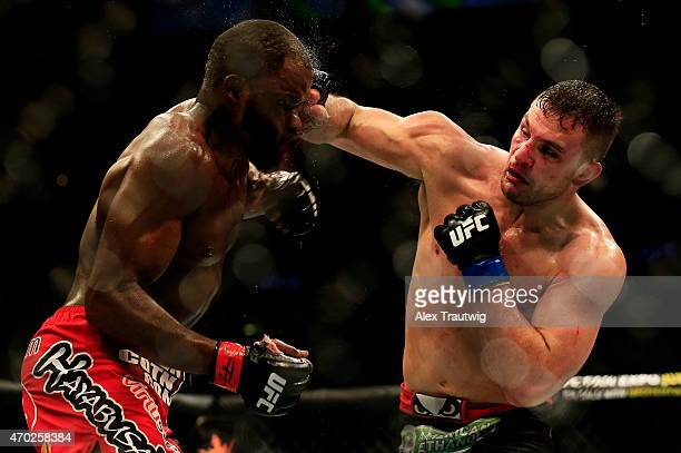 Gian Villante punches Corey Anderson in their light heavyweight bout during the UFC Fight Night event at Prudential Center on April 18 2015 in Newark...