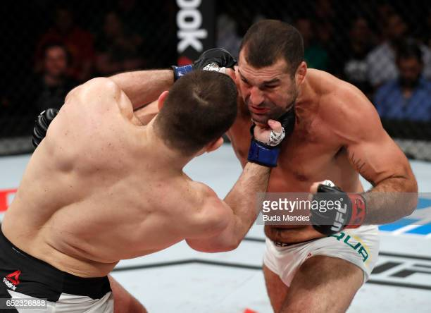 Gian Villante punches Mauricio Rua of Brazil in their light heavyweight bout during the UFC Fight Night event at CFO Centro de Formaco Olimpica on...