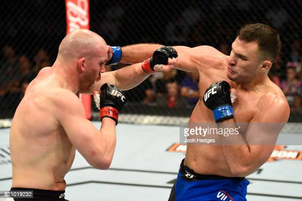 Gian Villante punches Patrick Cummins in their light heavyweight bout during the UFC Fight Night event inside the Nassau Veterans Memorial Coliseum...