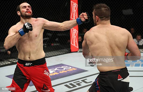 Gian Villante punches Saparbek Safarov of Russia in their light heavyweight bout during the UFC Fight Night event at the Times Union Center on...