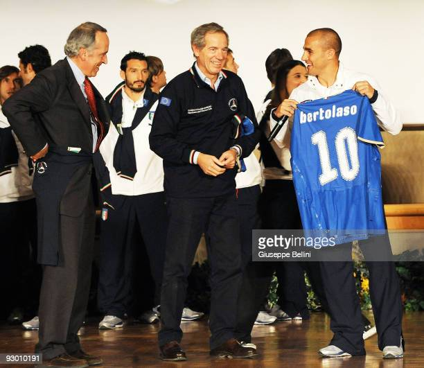 L'AQUILA ITALY NOVEMBER 12 Giancarlo Abete the President of FIGC Guido Bertolaso and Fabio Cannavaro speak during the Italy national soccer team...