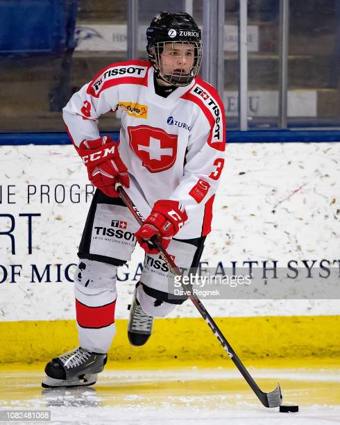 Giancarlo Chanton of the Switzerland Nationals skates up ice with the puck against the Russian Nationals during day one of game one of the 2018...