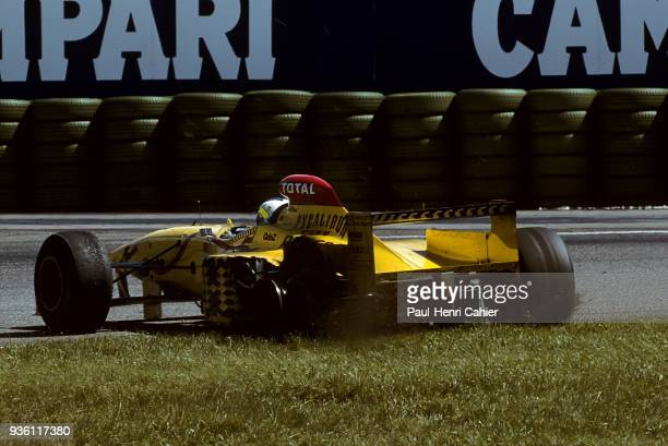 Giancarlo Fisichella, Jordan-Peugeot 197, Grand Prix of Germany, Hockenheimring, 27 July 1997. Giancarlo Fisichella on three wheels after a tyre...