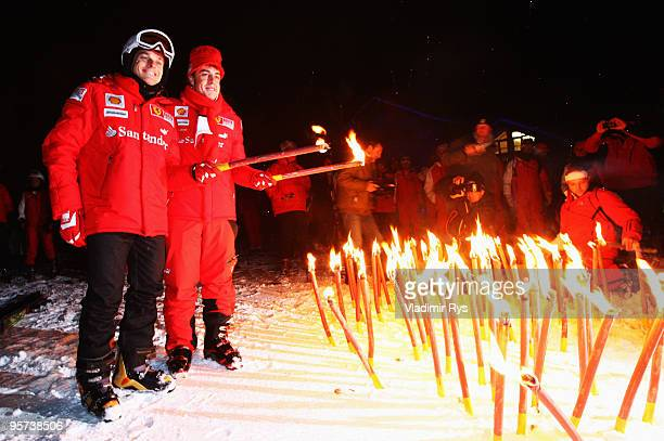 Giancarlo Fisichella of Italy and Fernando Alonso of Spain and Ferrari pose for a photo during the Wroom 2010 on January 12, 2010 in Madonna di...