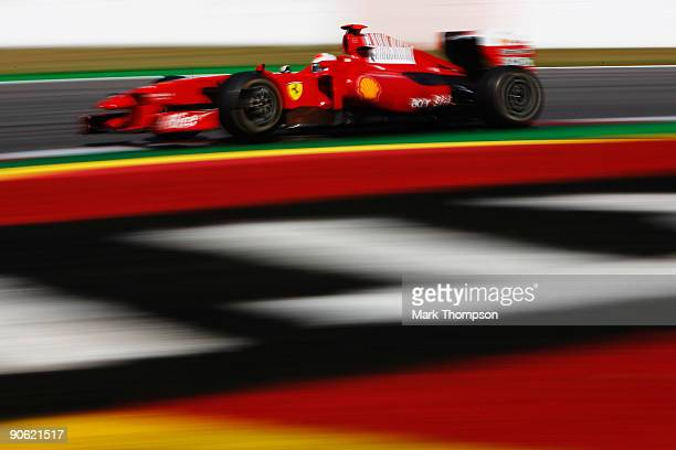 Giancarlo Fisichella of Italy and Ferrari drives during the final practice session prior to qualifying for the Italian Formula One Grand Prix at the...
