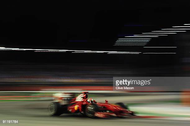 Giancarlo Fisichella of Italy and Ferrari drives during the Singapore Formula One Grand Prix at the Marina Bay Street Circuit on September 27 2009 in...