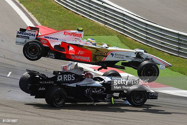 Giancarlo Fisichella of Italy and Force India and Kazuki Nakajima of Japan and Williams collide at the first corner at the start of the Turkish...