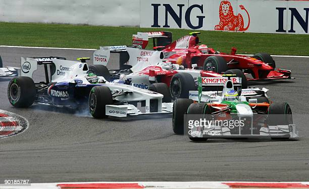Giancarlo Fisichella of Italy and Force India leads the field at the start of the Belgian Grand Prix at the Circuit of Spa Francorchamps on August 30...