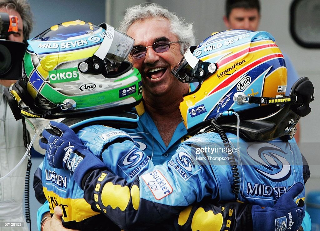 Giancarlo Fisichella of Italy and Renault celebrates his victory with team mate Fernando Alonso of Spain and team principal Flavio Briatore during the Malaysian Formula One Grand Prix at the Sepang Circuit on March 19, 2006, in Kuala Lumpur, Malaysia.