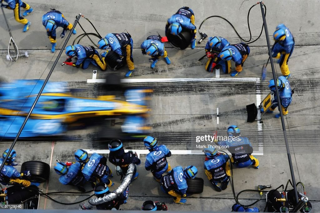 Giancarlo Fisichella of Italy and Renault makes a pit stop during the Malaysian Formula One Grand Prix at the Sepang Circuit on March 19, 2006, in Kuala Lumpur, Malaysia.