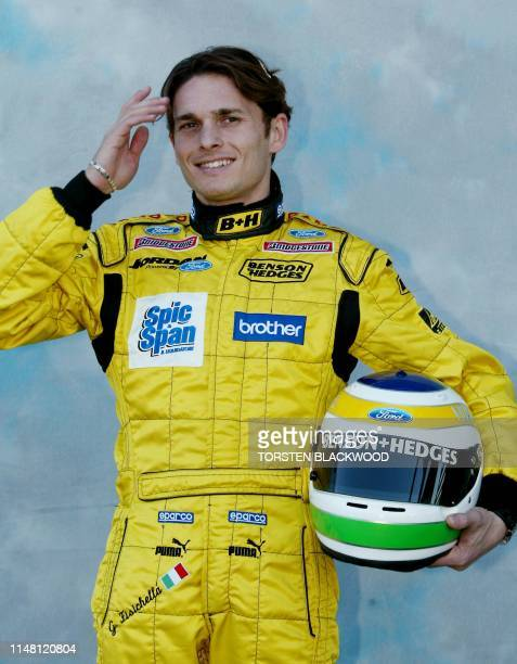 Giancarlo Fisichella of Italy displays his helmet on the eve of the first qualifying session of the Australian Formula One Grand Prix in Melbourne 06...