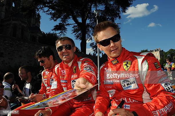 Giancarlo Fisichella of Italy Jean Alesi of France and Toni Vilander of Finland drivers of the AF Corse Ferrari 430 during the parade of drivers for...