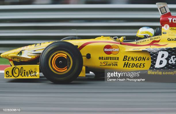 Giancarlo Fisichella of Italy lights up the brake discs as he drives the Benson & Hedges Total Jordan Peugeot Jordan197 Peugeot V10 during the...
