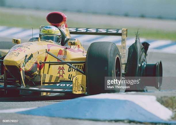 Giancarlo Fisichella of Italy suffers a rear blowout puncture driving the Benson & Hedges Total Jordan Peugeot Jordan 197 Peugeot A14 V10 during the...