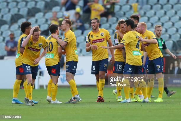 Giancarlo Gallifuoco of the Central Coast Mariners celebrates a goal with team mates during the round 7 ALeague match between the Central Coast...