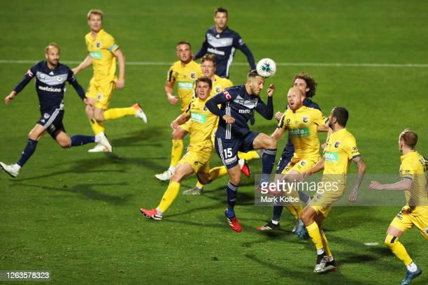 Giancarlo Gallifuoco of Victory heads a shot at goal during the round 26 A-League match between the Melbourne Victory v Central Coast Mariners at...