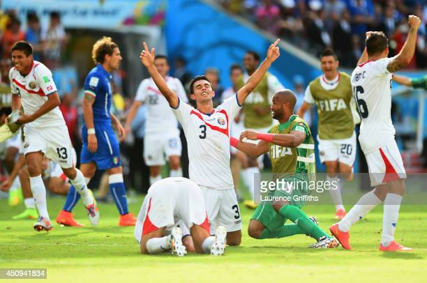 Giancarlo Gonzalez of Costa Rica celebrates with teammates after defeating Costa Rica 1-0 during the 2014 FIFA World Cup Brazil Group D match between...