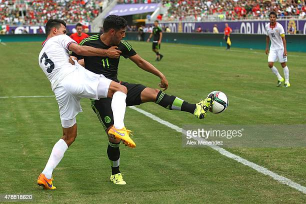 Giancarlo Gonzalez of Costa Rica grabs Alan Pulido of Mexico during an international friendly soccer match between Mexico and Costa Rica at the...