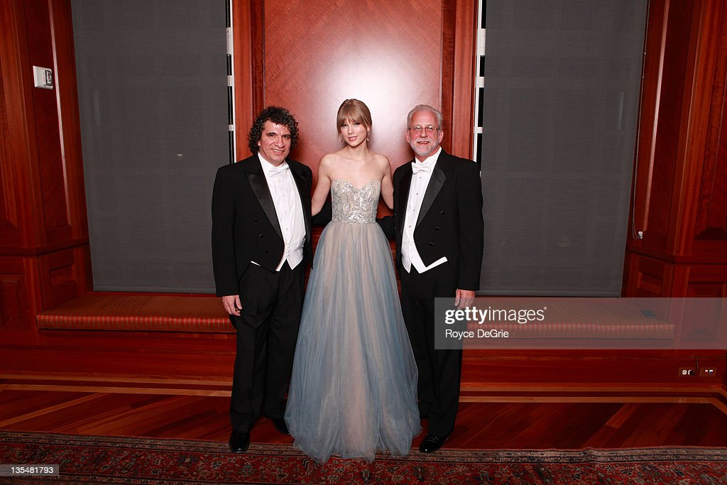 Giancarlo Guerrero, musician Taylor Swift, and Alan Valentine attend the annual Nashville Symphony Ball at the Schermerhorn Symphony Center on December 10, 2011 in Nashville, Tennessee. Swift, a 4-time GRAMMY winner, was honored with the Nashville Symphony's prestigious Harmony Award, recognizing her for exemplifying the unique harmony between the many worlds of music that exist in Nashville, and her significant contributions to the development and appreciation of musical culture. Earlier this month Swift was feted by Billboard magazine as their 2011 Woman of the Year, the youngest artist ever to receive this top honor. Last month she won Artist of the Year at the American Music Awards and was named Entertainer of the Year by the Country Music Association.
